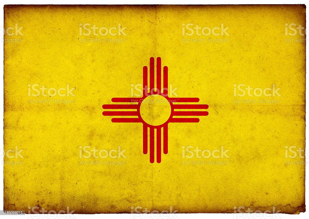 Grunge Flag of New Mexico on rough edged old postcard stock photo