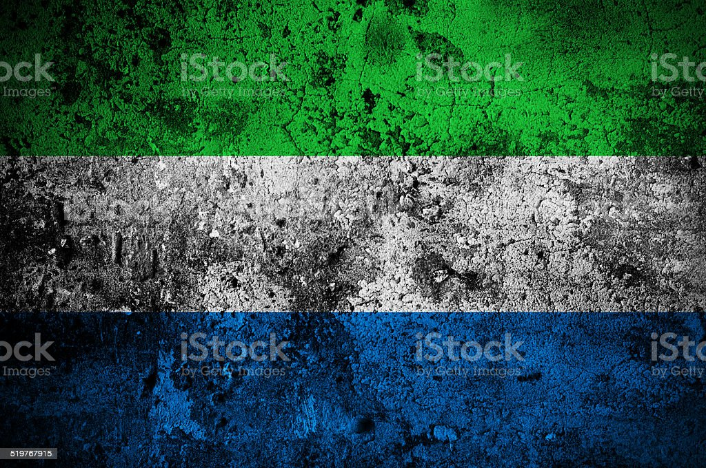 grunge flag of Sierra Leone with capital in Freetown stock photo