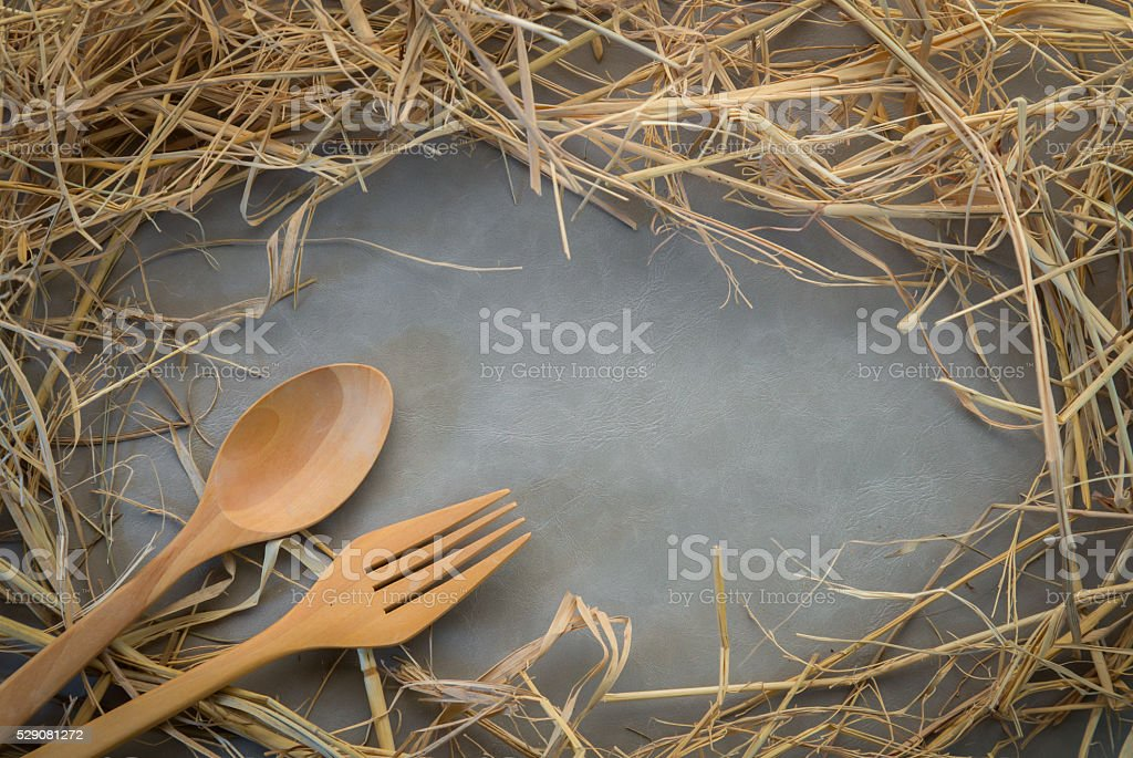 grunge frame made of straw with wooden spoon and fork stock photo
