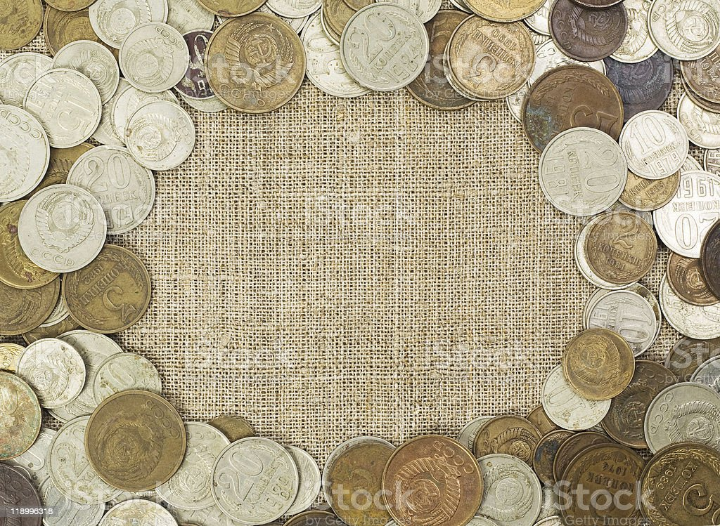 Grunge frame pattern of aged USSR coins on hessian canvas royalty-free stock photo