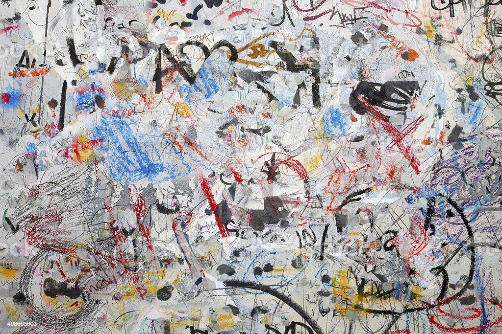 Grunge graffiti wall background: spray paint, strokes, coloured street art stock photo