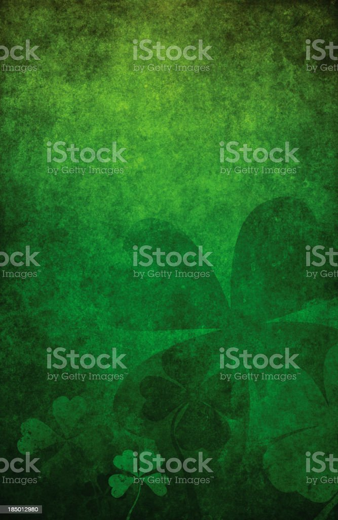 Grunge green background with four leaf clovers stock photo