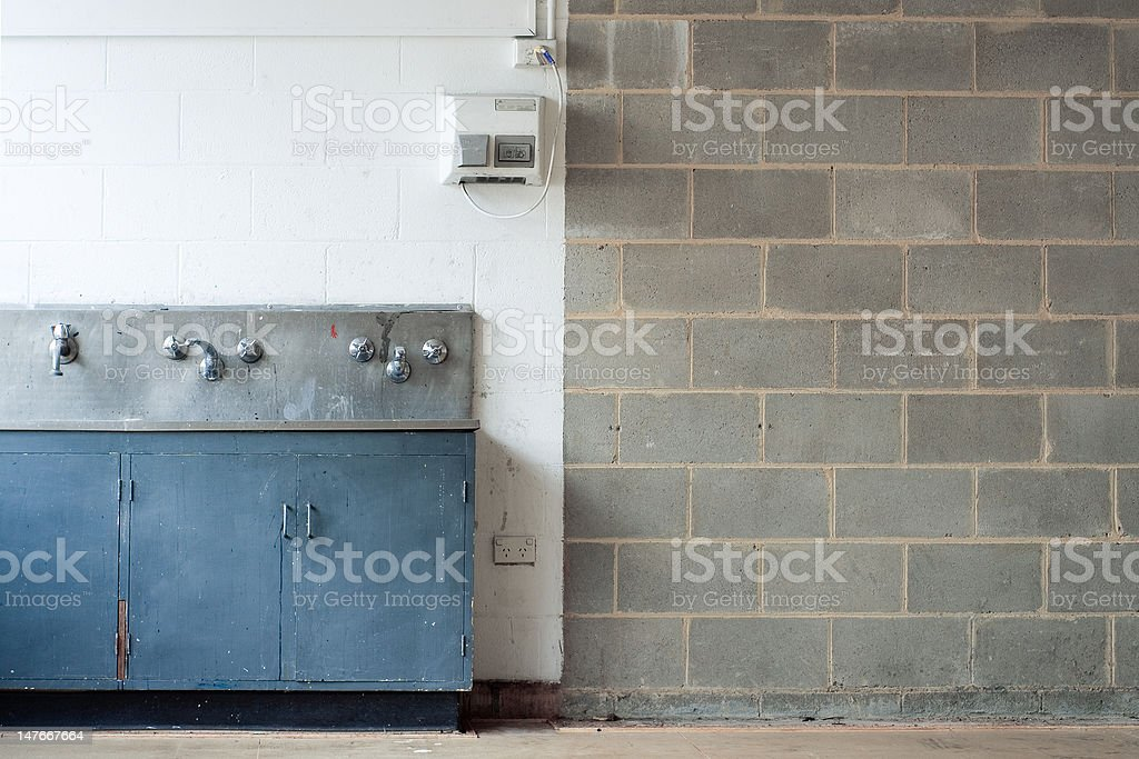 grunge interior with wall and washing trough stock photo