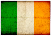 Grunge Irish Flag on rough edged old postcard