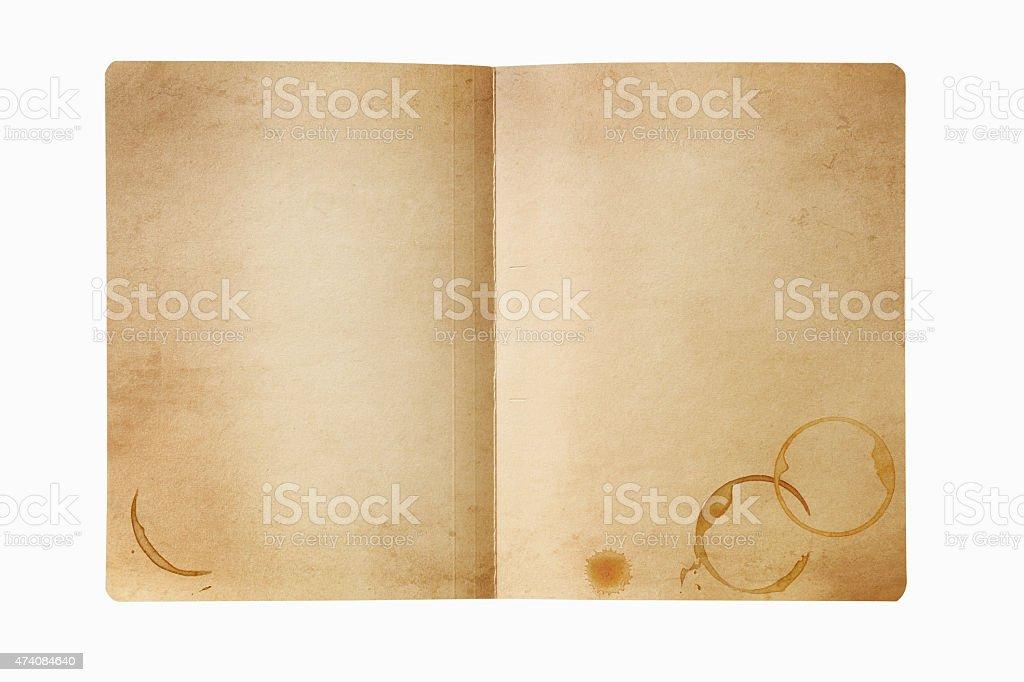 Grunge manila folder with coffee stains, isolated on white. stock photo