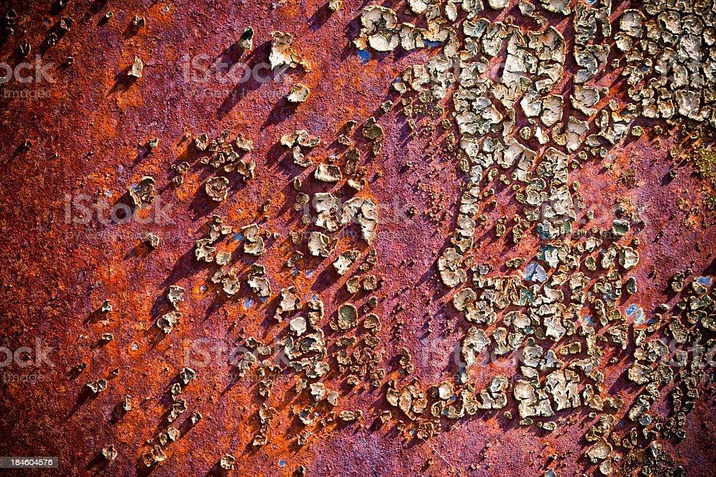 Grunge metallic background with peeling paint royalty-free stock photo
