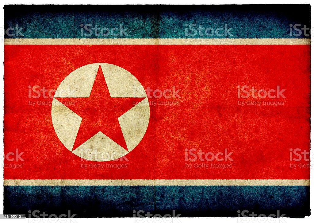 Grunge North Korean Flag on rough edged old postcard stock photo