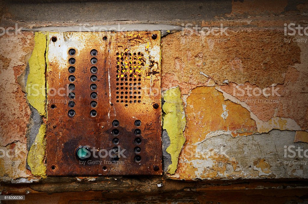 grunge old wall with intercom panel buttons background stock photo