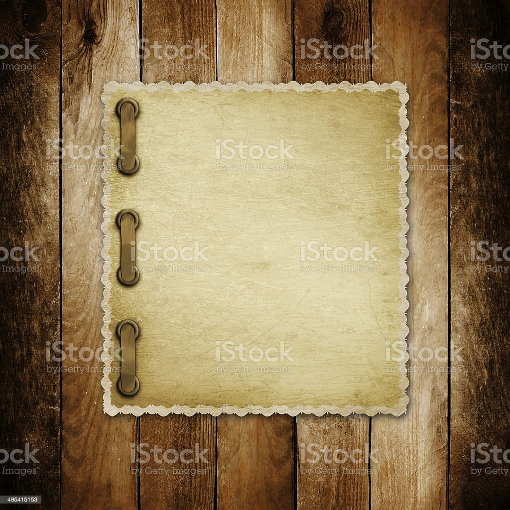 Grunge paper for invitation on the vintage wooden background stock photo