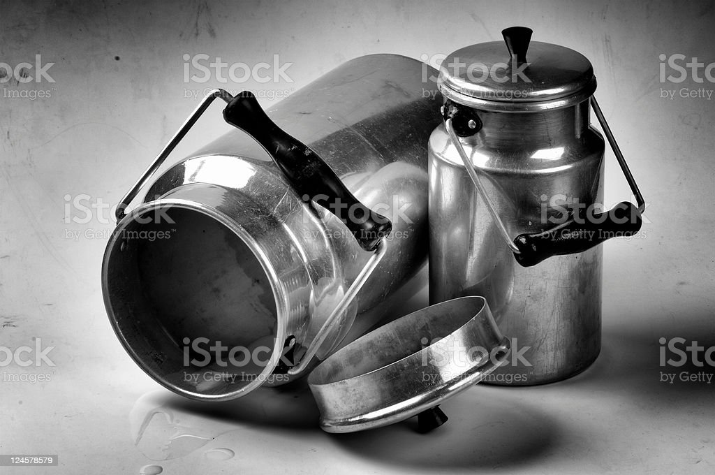 Grunge photo of vintage milk cans royalty-free stock photo