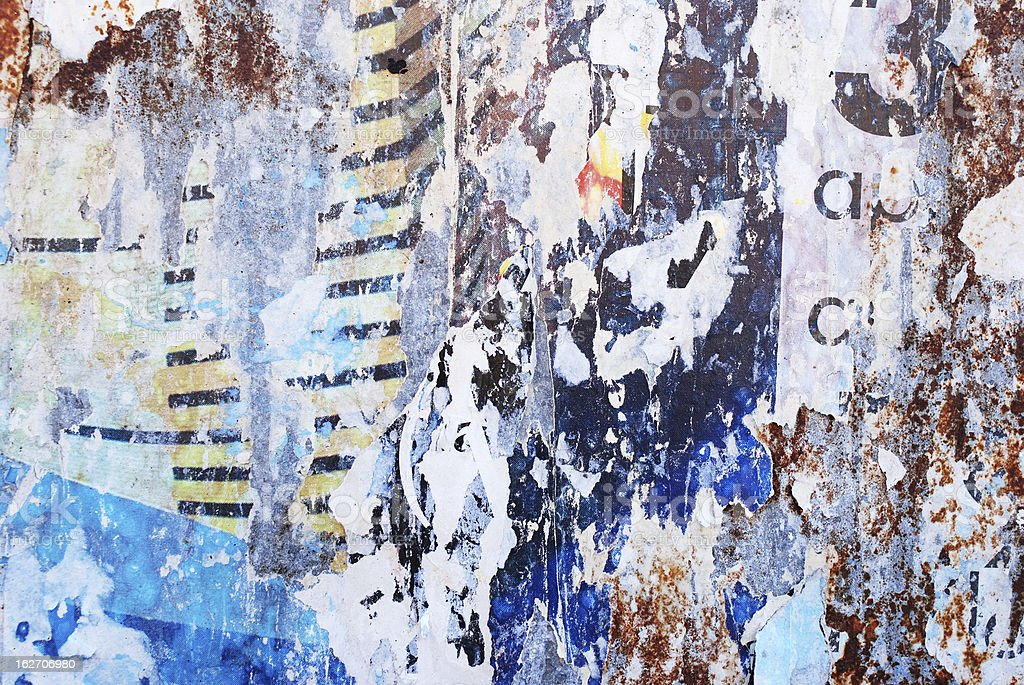 Grunge rusty billboard texture with torn paper royalty-free stock photo
