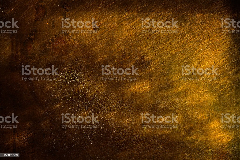 Grunge Scratched and pitted Gold Background stock photo