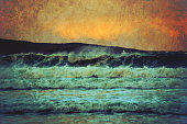Grunge seascape of rough surf at sunset