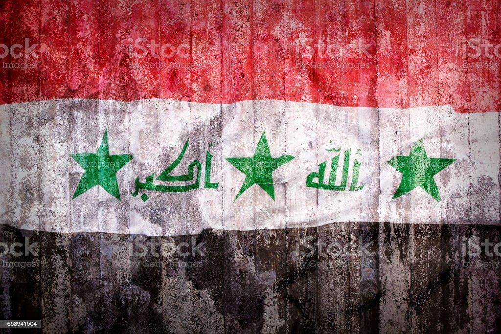 Grunge style of Iraq flag on a brick wall stock photo