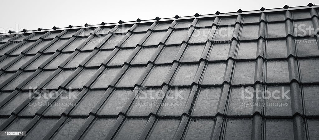 Grunge terracotta tiles on the roof of Norvegian old house royalty-free stock photo