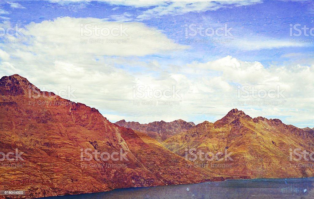 Grunge textured rugged Mountain range stock photo