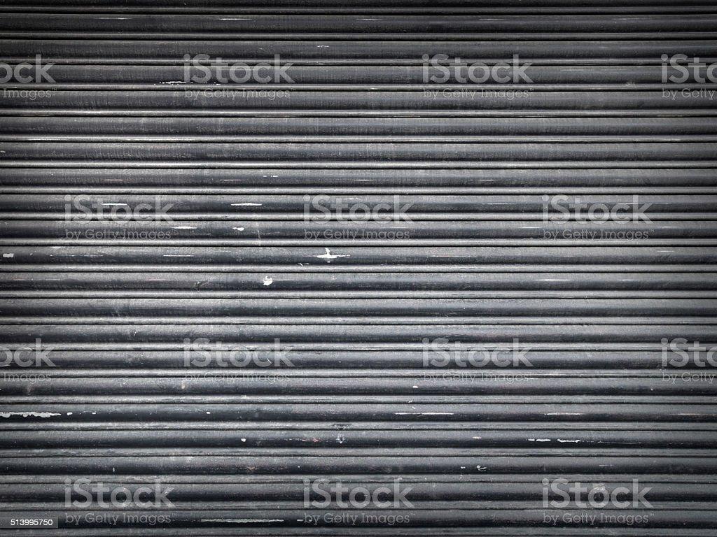 grunge urban roller shutter door - Stock Image stock photo