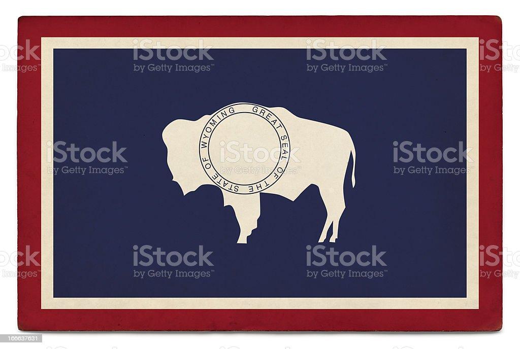 Grunge US state flag on white: Wyoming royalty-free stock photo