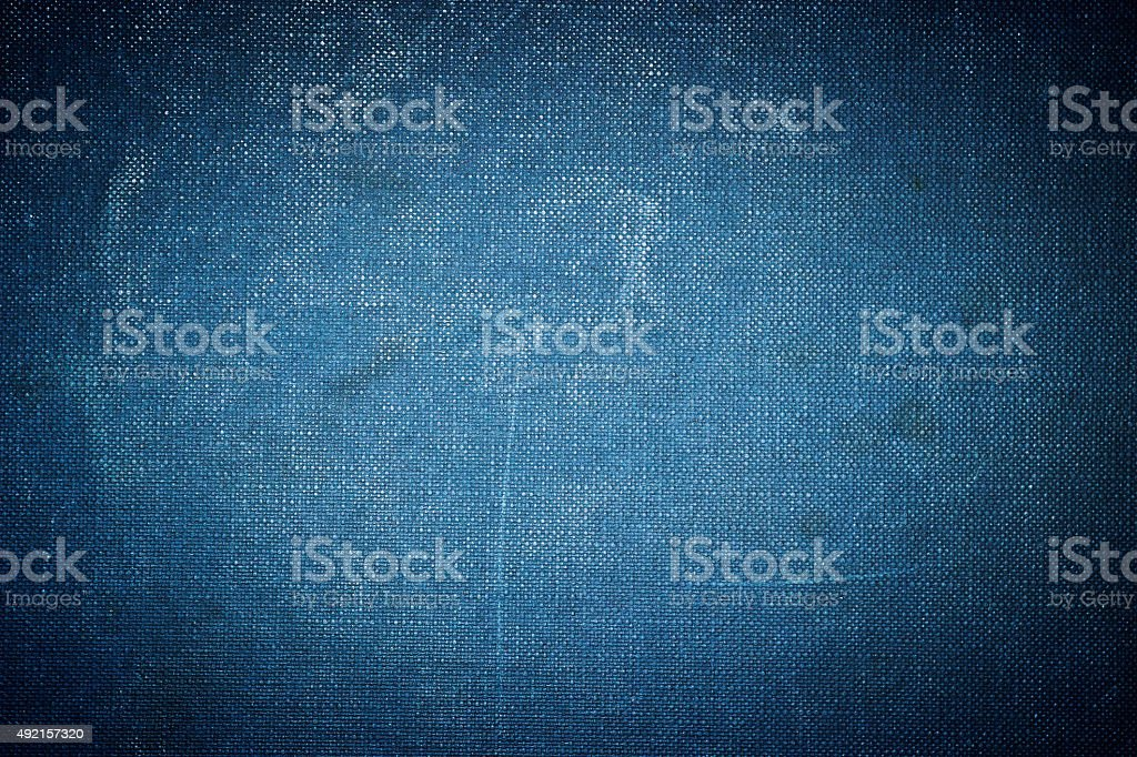 Grunge vignetted textile background - dark blue colored stock photo
