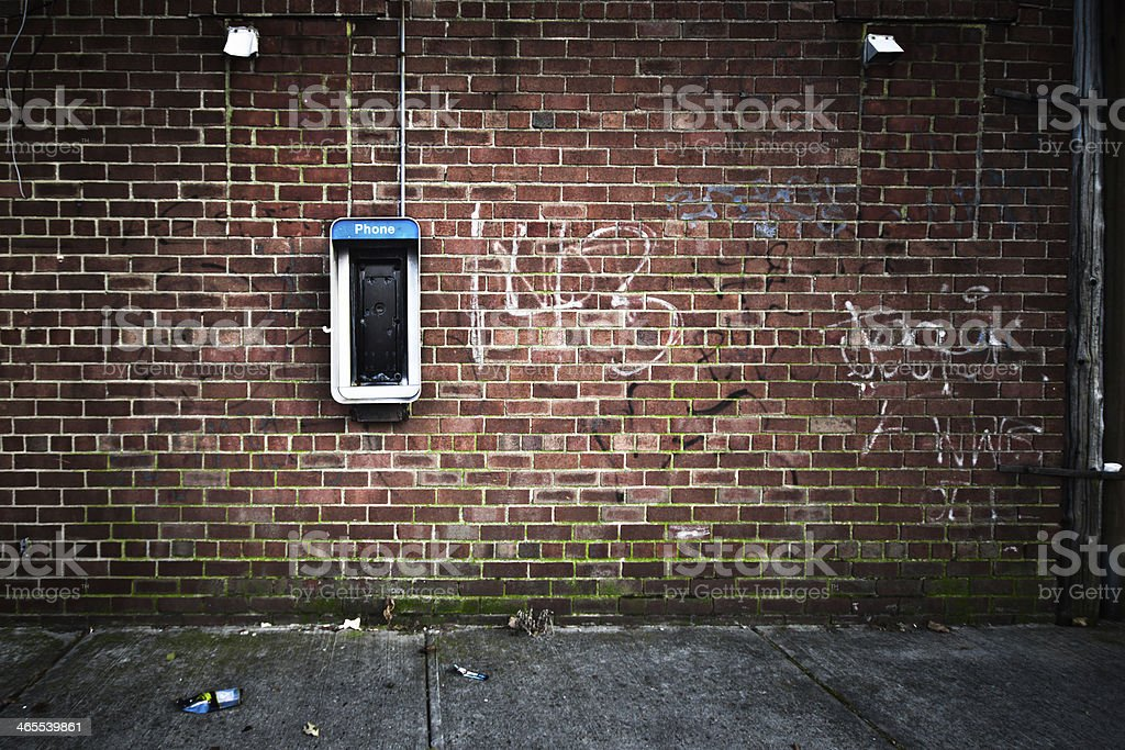 Grunge Wall and Payphone stock photo