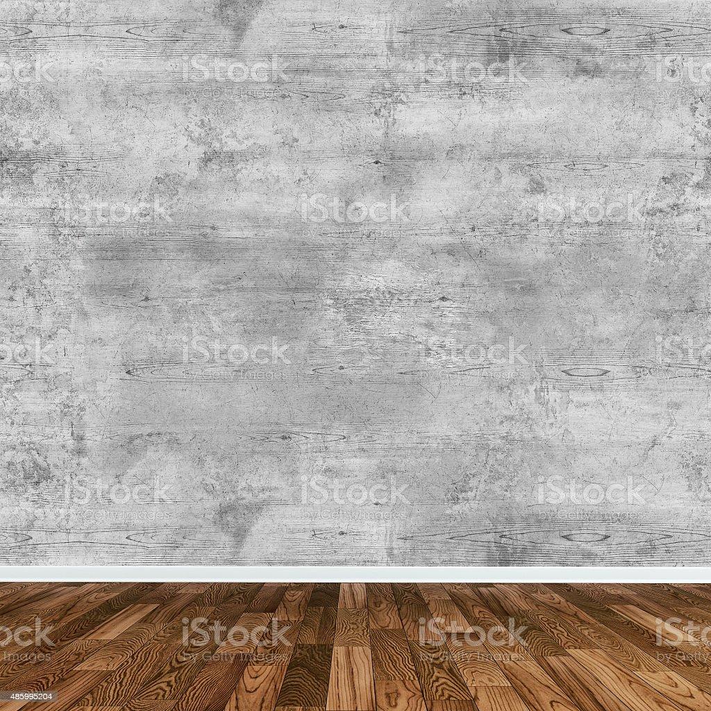 Grunge wall background on hardwood floor stock photo