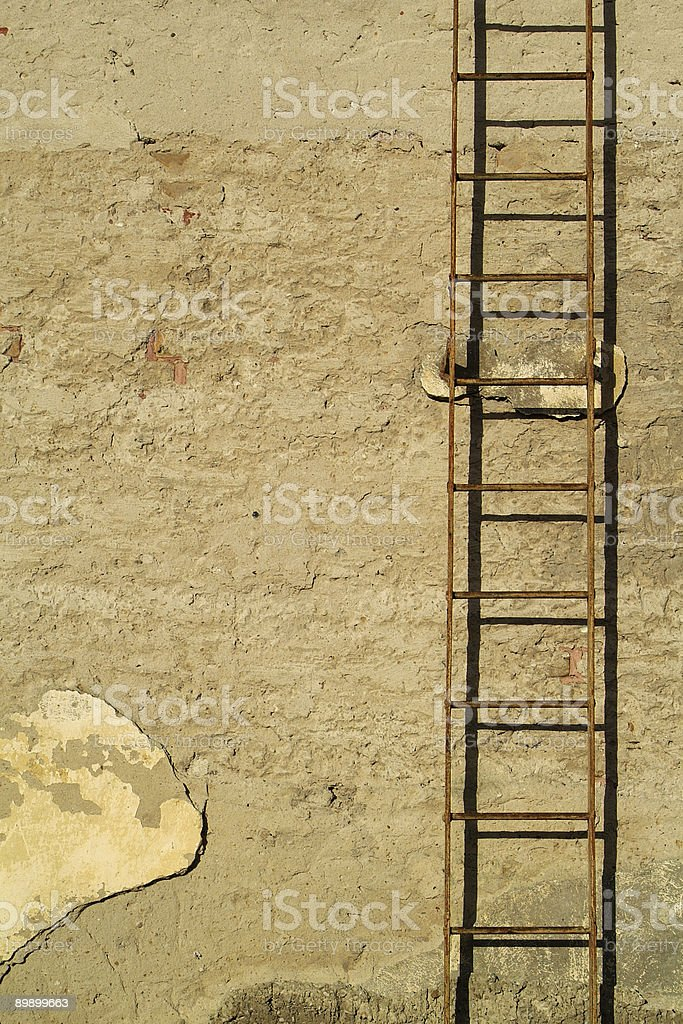 grunge wall with rusty ladder royalty-free stock photo