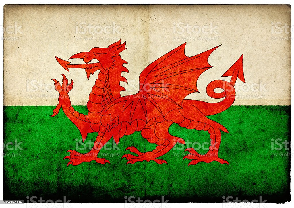 Grunge Welsh Flag on rough edged old postcard stock photo