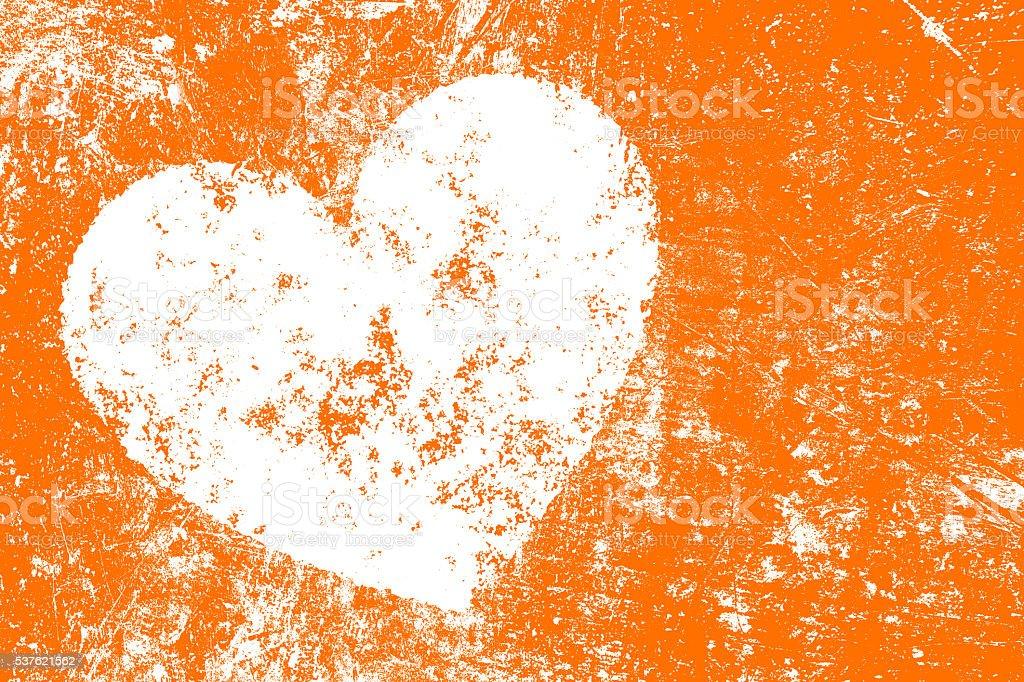 Grunge white heart on orange background stock photo