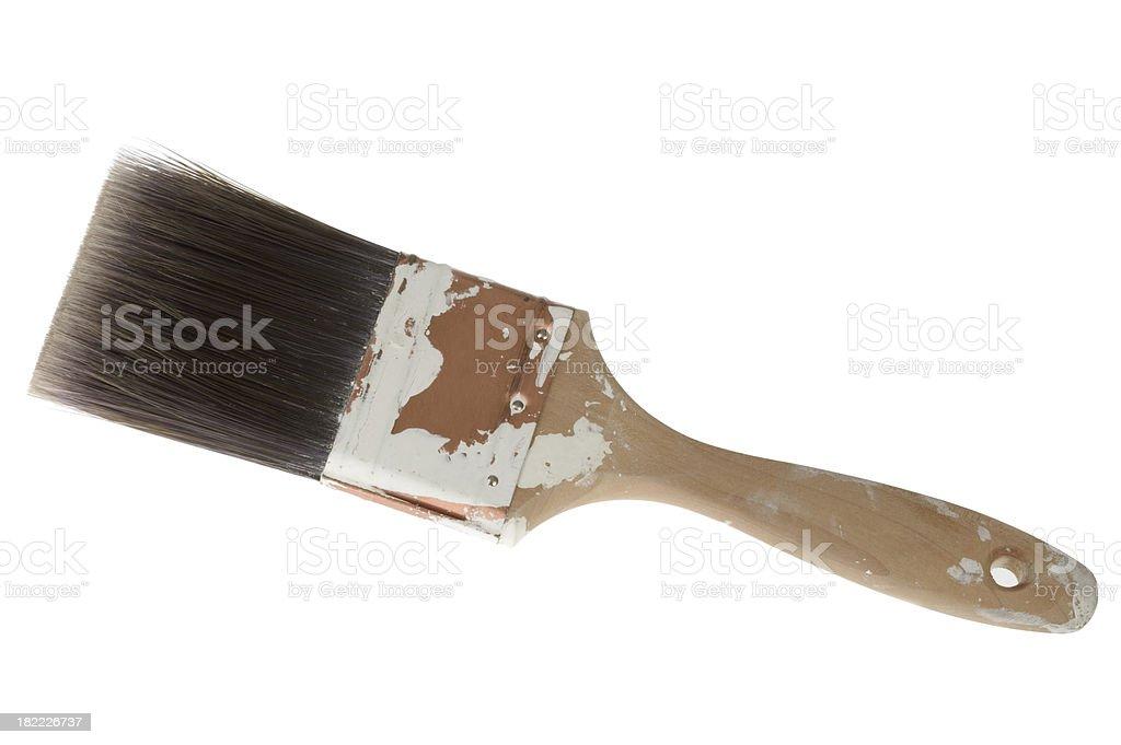 Grunge wooden paint brush on white background stock photo