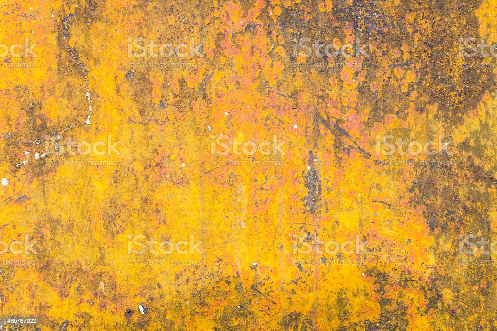 grunge yellow background with some spots and stains on it. stock photo