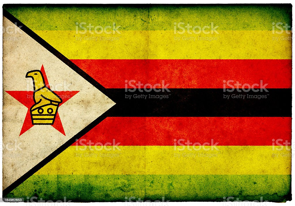 Grunge Zimbabwe Flag on rough edged old postcard royalty-free stock photo