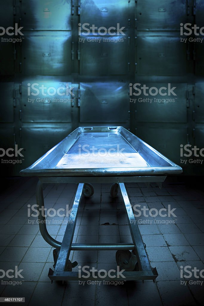 Grungy and high contrast photo of morgue trays stock photo