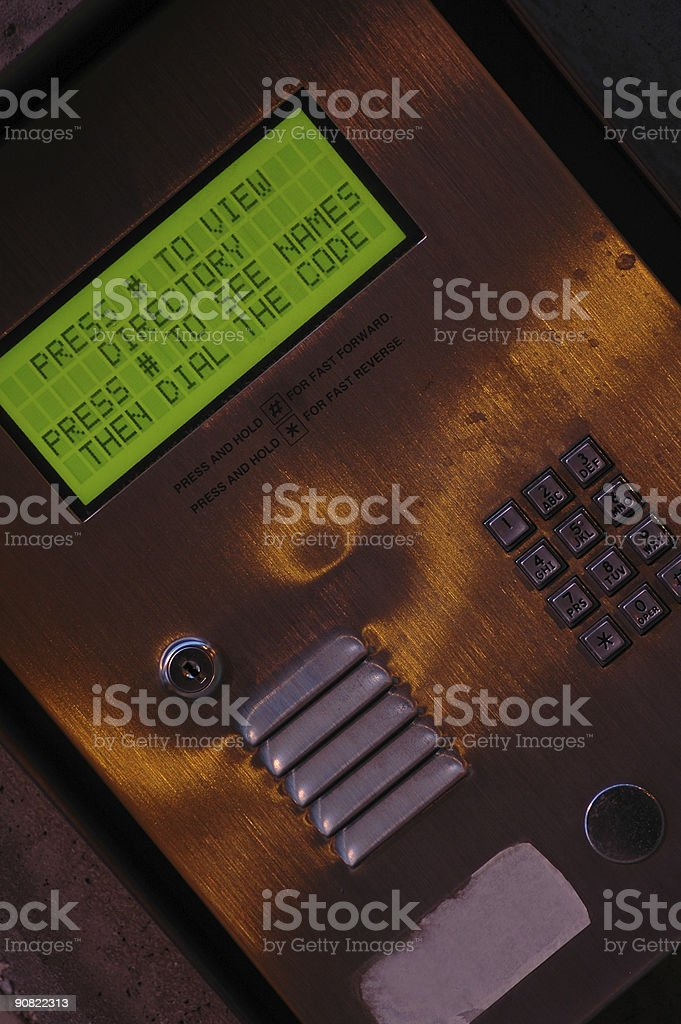 Grungy Apartment Intercom Directory at Night stock photo