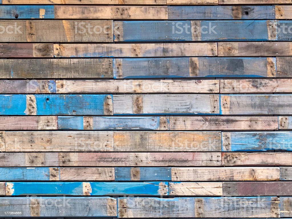 Grungy blue painted wood planks of exterior siding stock photo