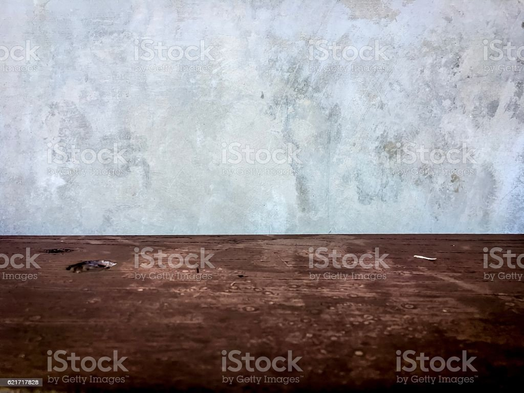 Grungy concrete wall and wooden floor room as background royalty-free stock photo