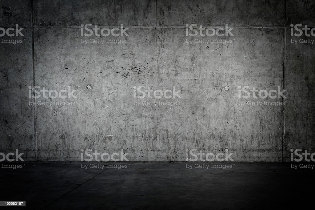 Grungy concrete walls and floor as background in grey tones stock photo