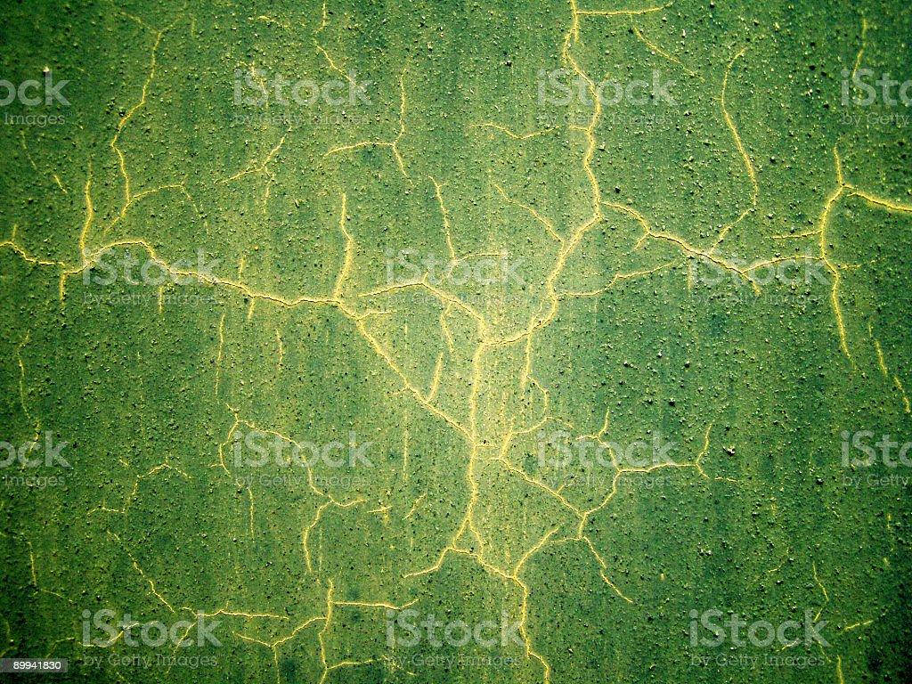 Grungy cracked green wall stock photo
