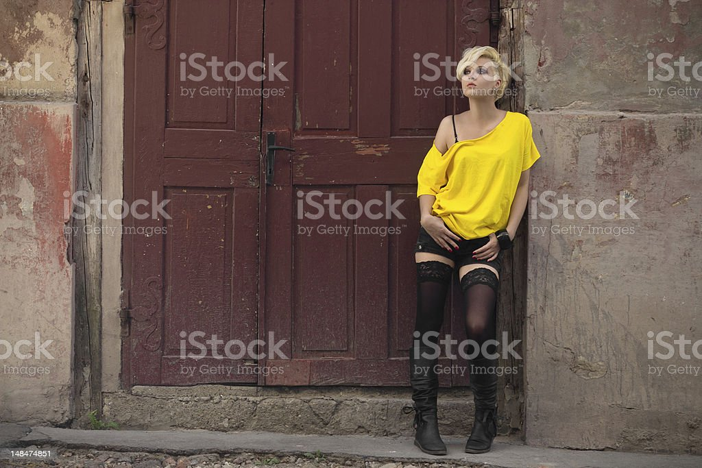 Grungy girl in a doorway stock photo