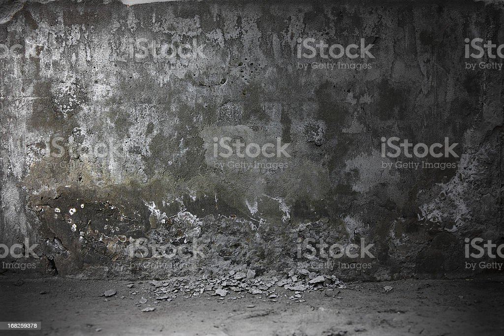 Grungy looking concrete wall in a dark environment royalty-free stock photo