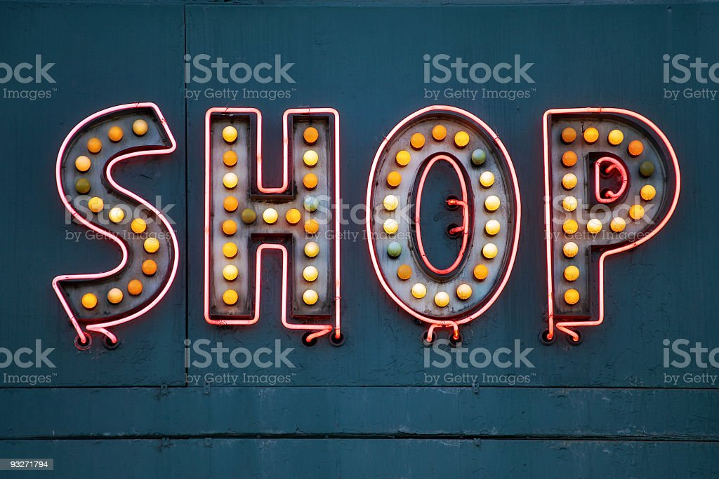 A grungy neon sign saying SHOP stock photo