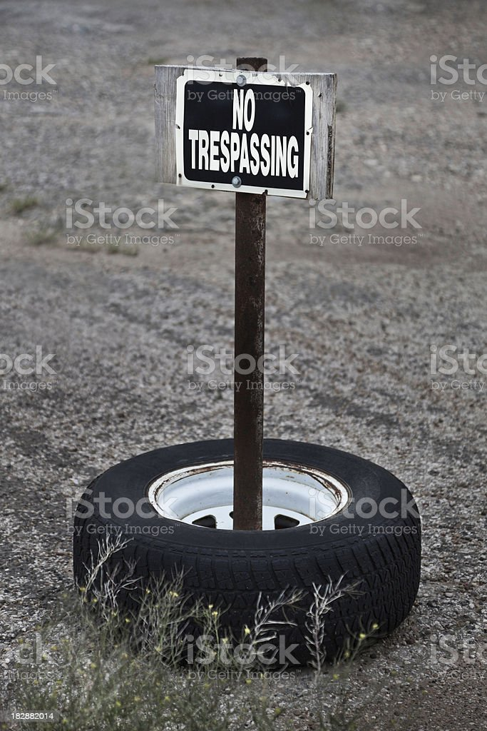 grungy no trespassing sign royalty-free stock photo