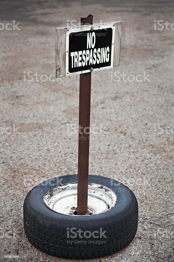 grungy no trespassing sign royalty-free stock photo