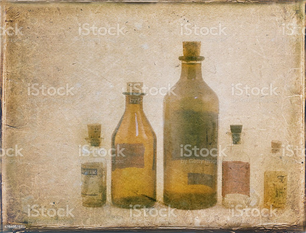Grungy photo of small vintage translucent glass medicine bottles. royalty-free stock photo