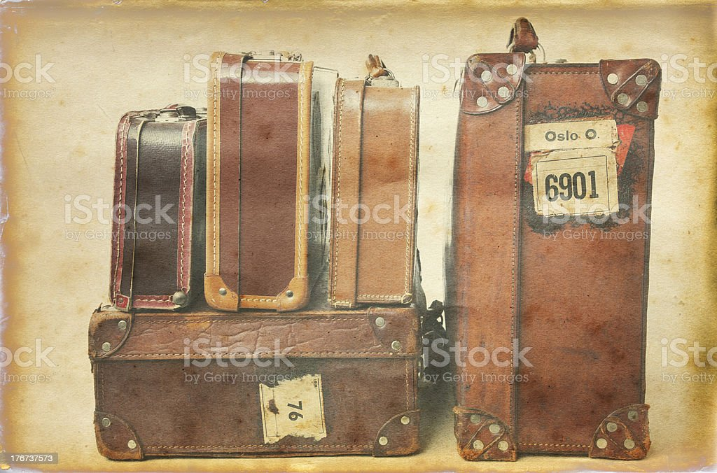Grungy photo of vintage suitcases in a heap. royalty-free stock photo