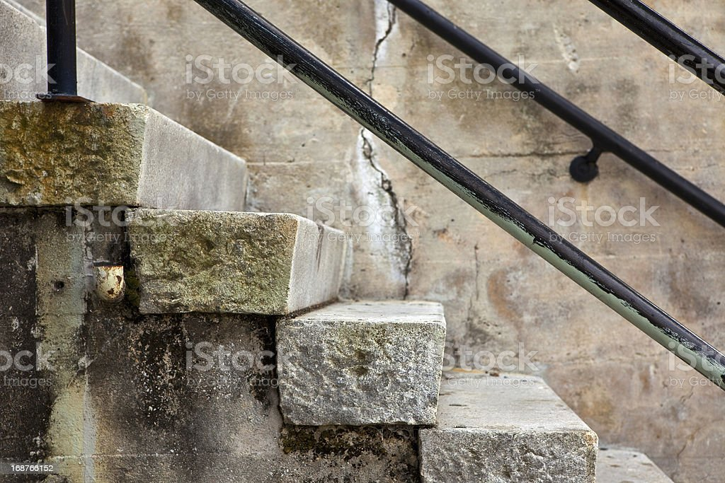 Grungy Stone Steps and Handrails royalty-free stock photo