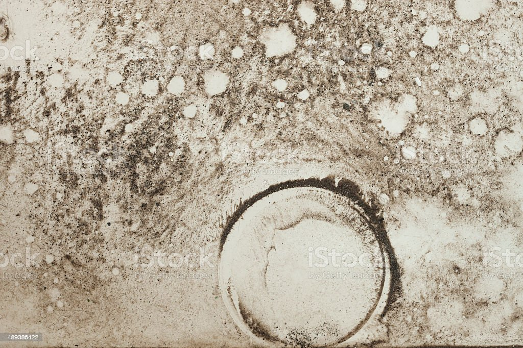 Grungy textured background of dirt and water on white tile. stock photo
