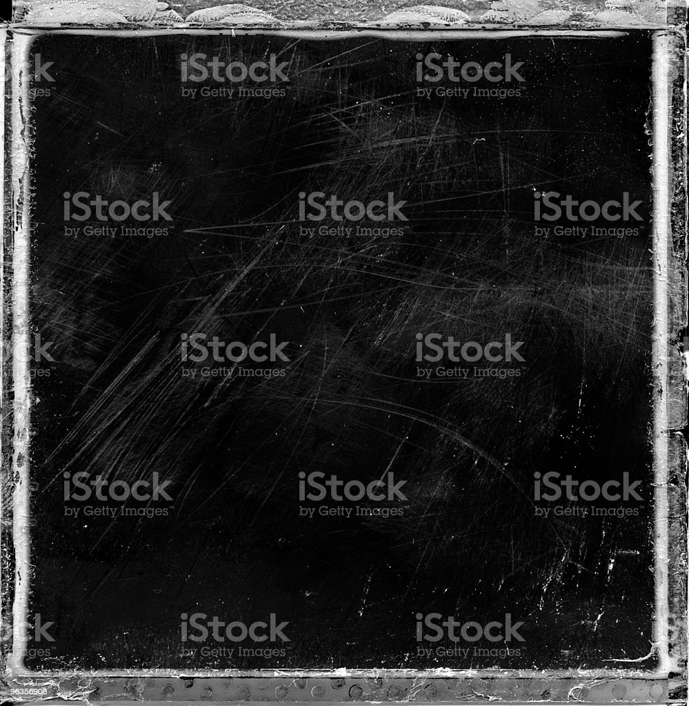 Grungy trashed film frame royalty-free stock photo