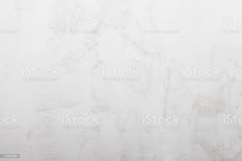 Grungy white painted concrete wall background stock photo