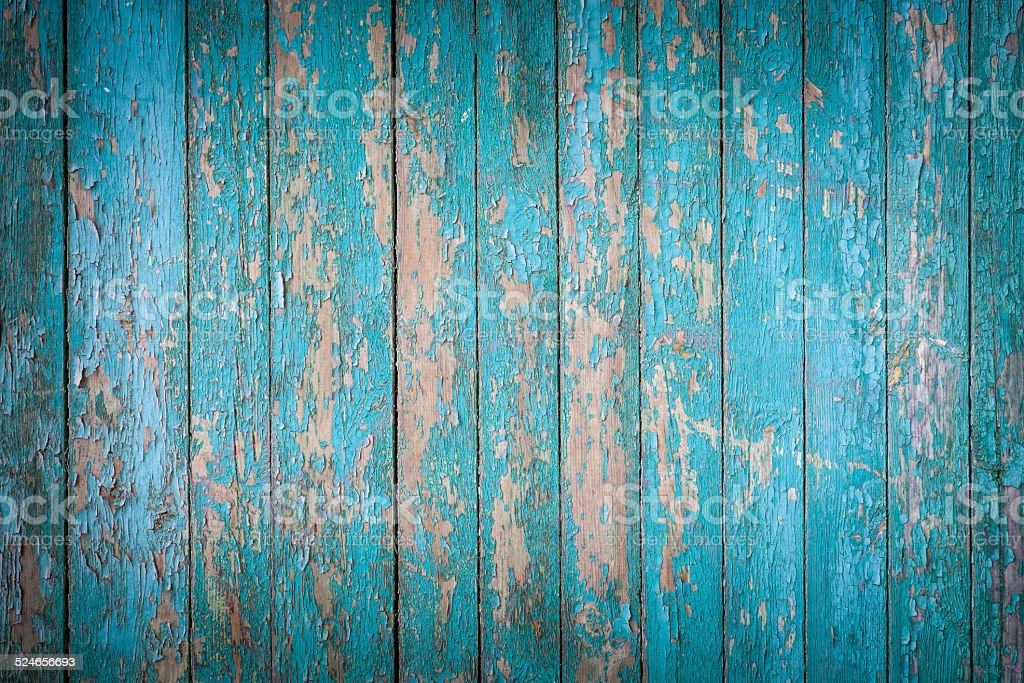 Grungy wood planks with blue peeling paint stock photo