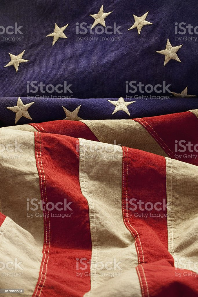 Grungy, Yellowed Betsy Ross Flag With Thirteen Stars and Stripes stock photo
